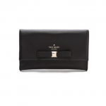 black leather Kate Spade New York clutch with a bow on the front and a slim pocket at the back