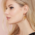 Nasty Gal Gold Wing and a Prayer Tunnel Earrings feather detailing