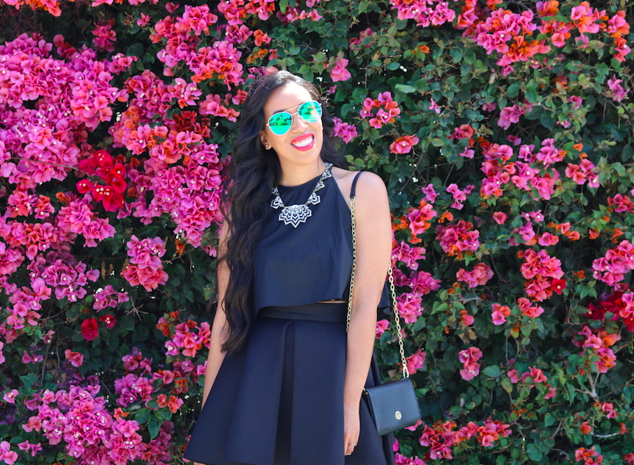 Finding the Perfect Backdrop - An all black outfit against bright pink blooms