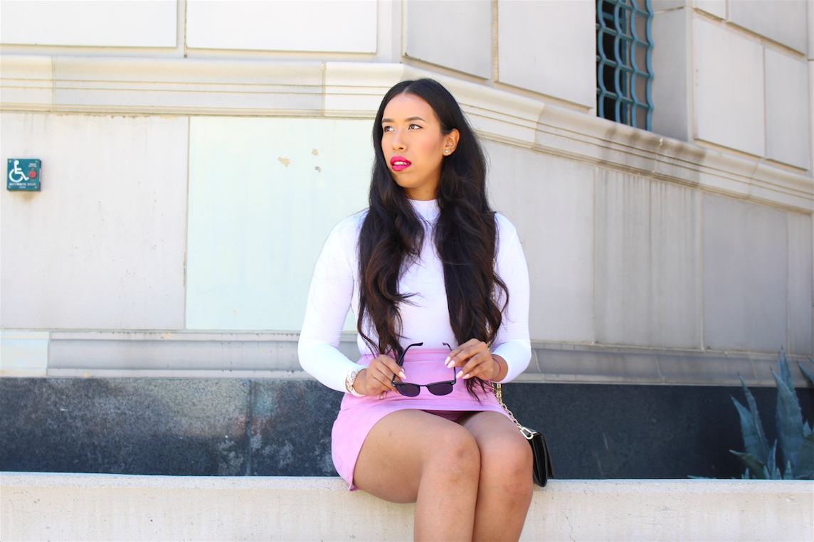 Today's post is more of a style tips guide on how to wear a pink suede mini skirt outfit. Suede is usually thick, kind of heavy and can get hot really fast even if it's faux. So, when you wear it during summer it's best to wear it as a skirt. In my opinion, leave the suede jackets and body hugging dresses for fall, or if you must wear them do it after 7pm, once the day starts cooling down a bit and you won't be miserable. When I saw this skirt for the first time I just knew it was going to be a staple in my closet. I know the color will be a little hard to wear all year round, but I think I can make it work even in December. For now though, it's perfect! We are still in summer and blush pink is the IT color. It's boxy shape provides a girly chic structure, somewhat inspired by the 70's. The golden details make the skirt seem even more special and expensive. In order to make this suede mini pop even more I knew I had to pair it with a well fitted bodysuit. Doing this would make the color stand out even more! (as if that's possible ;)) lol. However, since the skirt is mini, and I was wearing it during the day while on-the-go, I made sure to wear a long sleeve bodysuit. This balanced the entire look and made me feel comfortable all day long. I didn't have to worry about anything slipping, popping out, or riding up. If I were to be wearing it for a night out with the girls then I would've definitely worn it with a deep V-neck bodysuit and strappy heels.